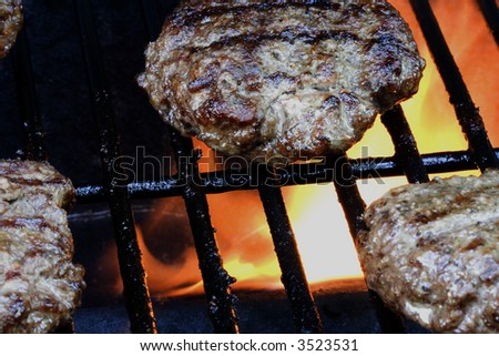 Grilling burgers on the bbq in the backyard for summer fun