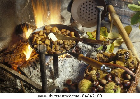Grilling chestnuts on an open fire