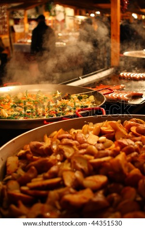 Grilling sausages in the Budapest Xmas Market. This market is regarded as one of the best 10 in Europe. Stock fotó ©