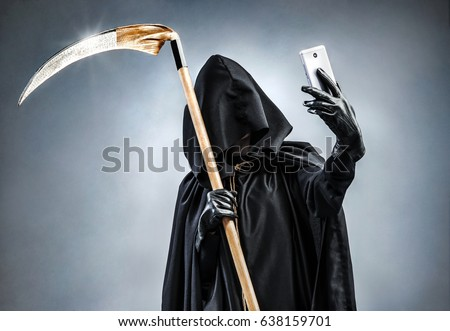 Grim Reaper making selfie photo on smartphone. Photo of personification of death wielding a large scythe in silhouette. Stock photo ©