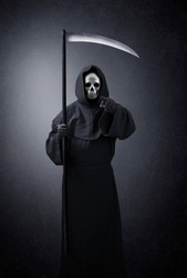 Grim reaper pointing at you in the dark