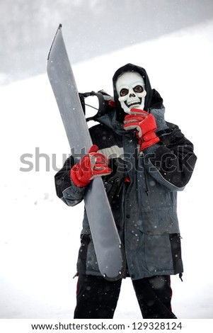 Grim reaper with snowboarder