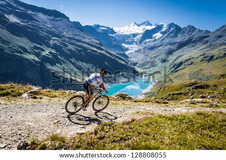 GRIMENTZ, SWITZERLAND � AUGUST 20: An unidentified rider in the Grand Raid winds his way from Verbier to Grimentz August 20, 2011. The event's 24th edition will be held on the 23 & 24 august 2013.