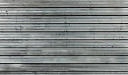 Grimy metal roller shutter (door)