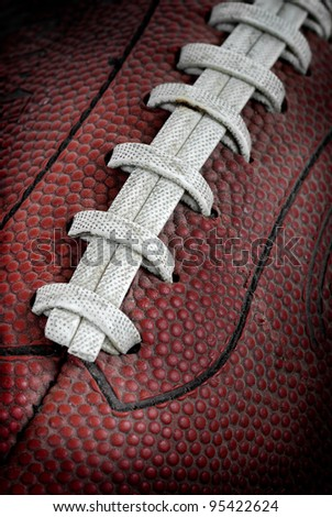 Grimy Old Football Closeup - dramatic light football covered in dust/dirt - stock photo