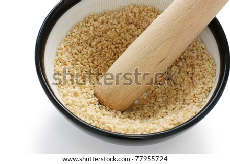 grind sesame with mortar and wooden pestle