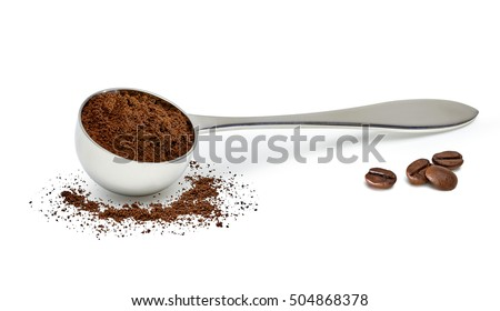 Grinded coffee powder in measuring scoop on white background with beans