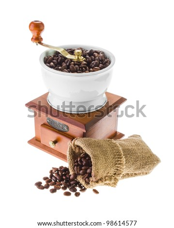 grinder and coffee beans isolated on white background