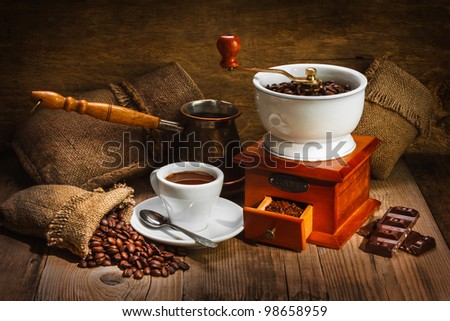 grinder and other accessories for the coffee in an old-style - stock photo