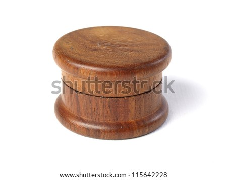 Grinder marijuana detail. The photo shows a macro photo of a wooden grinder in vertical composition.