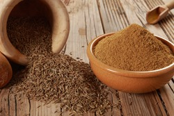 Grinding Cumin a dried plant crop into powder using grater along with mortar and pestle