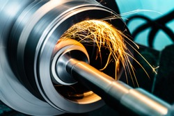 grinding metal on the machine, abrasive stone on the rim with sparks.