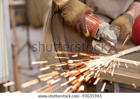 grinding the head of screws making sparks