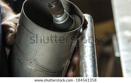 Grinding the inside of a metal cylinder