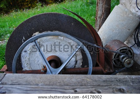 grinding wheel for sharpening metal blades - stock photo
