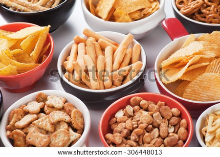 Grissini sticks, potato chips and other salty snacks