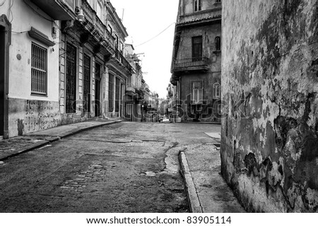 Gritty black and white image of an old street in Havana - stock photo