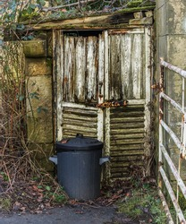 Gritty old shed doors and a dustbin in need of some care and attention