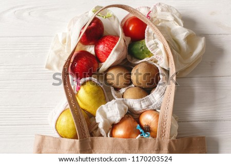 groceries in eco bags. eco natural bags with fruits and vegetables, eco friendly, flat lay. sustainable lifestyle concept. zero waste food shopping. plastic free items. reuse, reduce, recycle, refuse