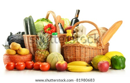 Groceries in wicker basket isolated on white. Vegetables, fruits, bakery products, dairy and wine. - stock photo