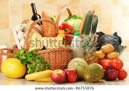 Groceries in wicker basket on kitchen table
