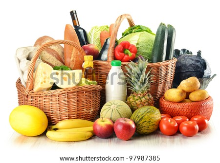Groceries in wicker baskets isolated on white. Fresh vegetables, fruits, dairy and bakery products and wine.