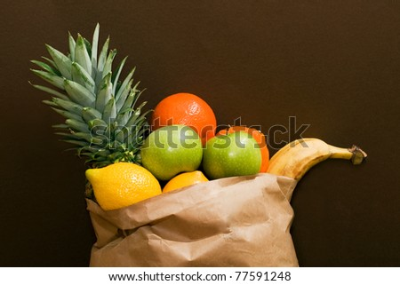 Grocery bag full of healthy fruits.