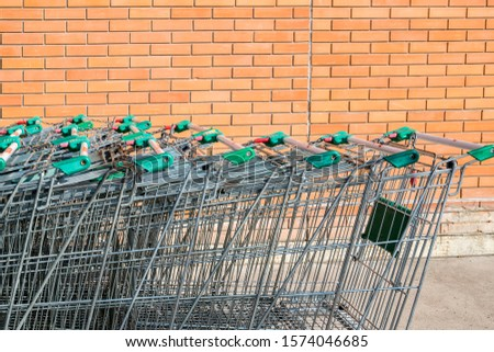 Grocery carts, a metal cart in a supermarket #1574046685