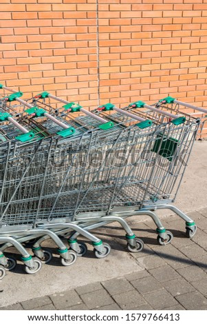 Grocery carts, a metal cart in a supermarket #1579766413