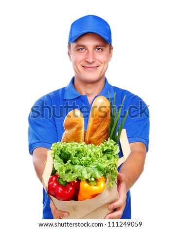 Grocery delivery courier in  blue uniform with a paper bag with food