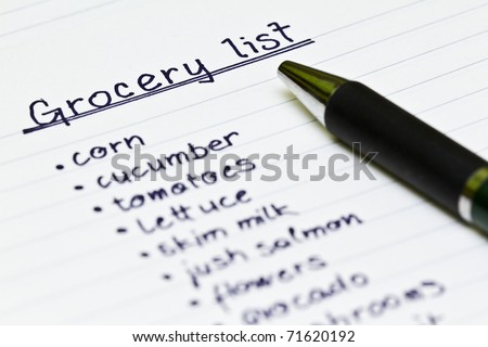 Grocery list with metal ball point pen