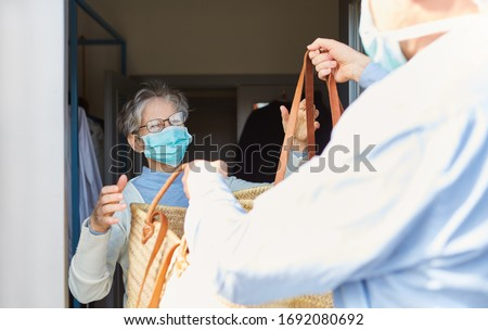 Grocery shopping as a delivery service for quarantined seniors at the Covid-19 Coronavirus epidemic