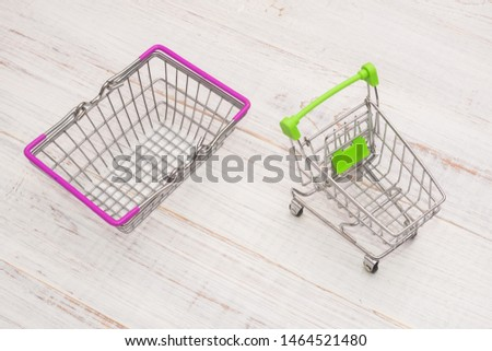 Grocery shopping cart and cart on a wooden background. #1464521480