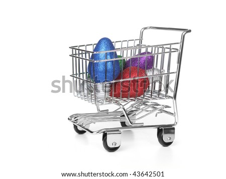 Grocery Shopping Cart With Ornaments In the Basket on White