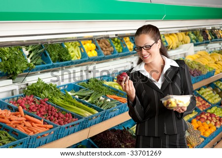 Grocery store - Business woman holding apple and fruit salad