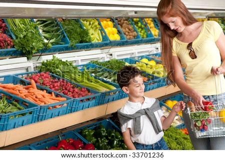 Grocery store - Red hair woman with child in grocery store