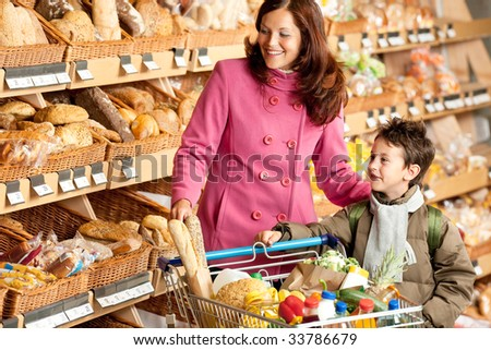 Grocery store - Smiling woman with child in a supermarket
