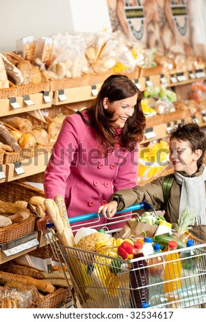 Grocery store - Woman with child in winter outfit in a supermarket