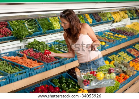 Grocery store - Young woman buying vegetable in grocery store