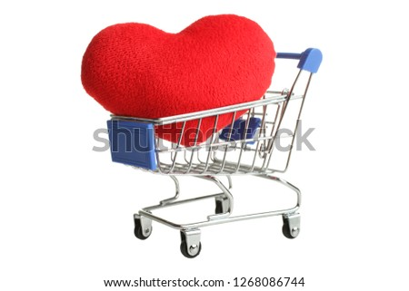 Grocery trolly  with one big red heart isolated on white. Holiday, Valentine's Day.