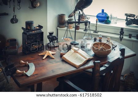 Grodno, Belarus - April 5, 2017: apothecary table with drugs and vintage equipment in the pharmacy museum of Grodno city. Grodno, Belarus. #617518502