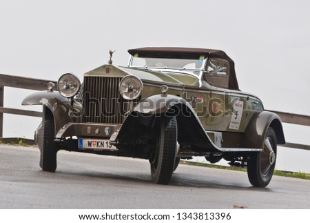 groebming, austria, 10 july 2014, ennstal classic, competition for vintage cars on mountain stoderzinken #1343813396