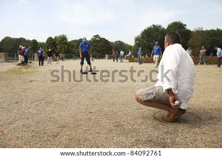 GRONINGEN, THE NETHERLANDS-AUGUST 20TH: Man playing the game of petanque at the Martini Masters tournament in Groningen, the Netherlands on 20th of August, 2011