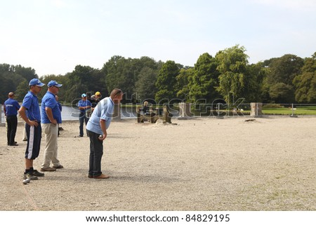 GRONINGEN, THE NETHERLANDS-AUGUST 20: Unidentified man playing the game of petanque at the Martini Masters Jeu de Boules tournament in Groningen, the Netherlands on 20th of August, 2011