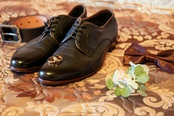 Groom accessories. Wedding shoes.Shoes, belt, watch, bow tie, rings.