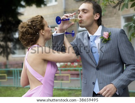 groom and bride drink
