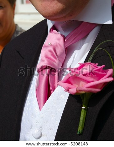 Groom at wedding with buttonhole