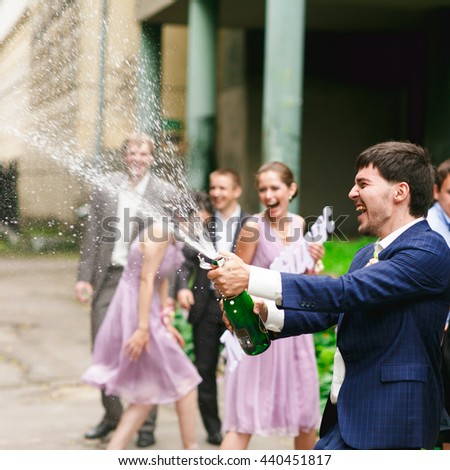 Groom breaks out the champagne on the street