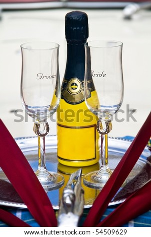 Groom & Bride Wedding Glasses with Yellow Champagne Bottle on a Silver Plate