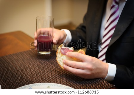 Groom eating breakfast